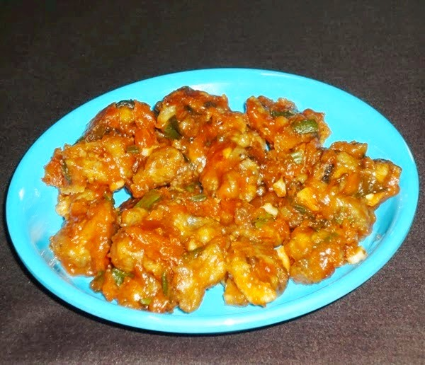 mushroom manchurian in a serving plate