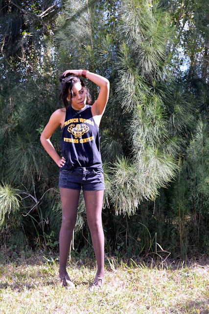 Fashion Blogger Anais Alexandre of Down to Stars in a DIY American Apparel T-shirt with Forever 21 shorts and Urban Outfitter sneakers