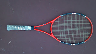 orange and white tennis racquet