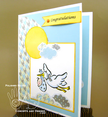 Picture of the front of the baby card set at an angle to the left to show dimension of the elements on it.