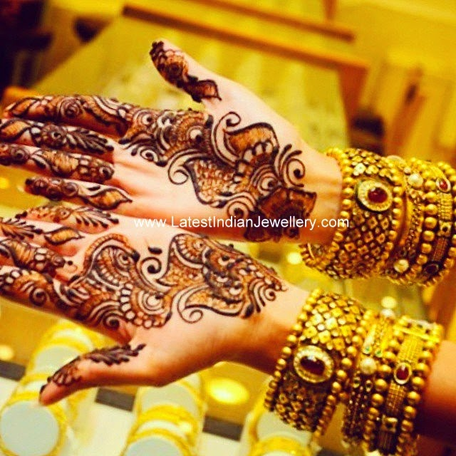 Mehandi hands with designer bangles