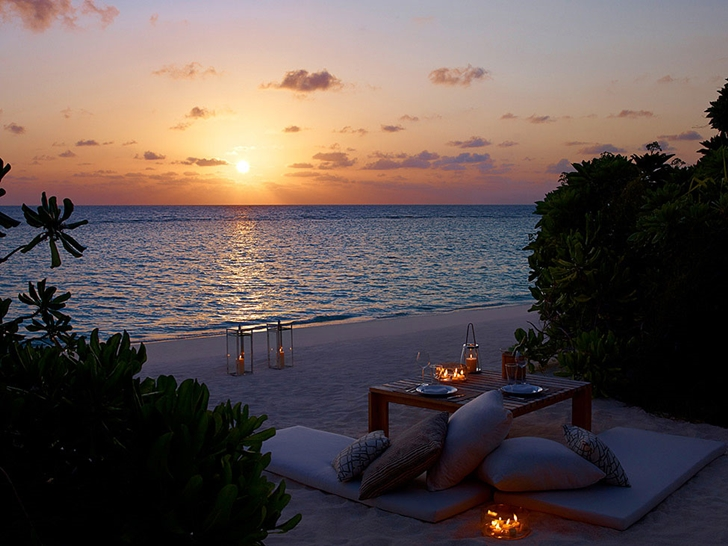 Beach at sunset in Luxury Dusit Thani Resort in Maldives