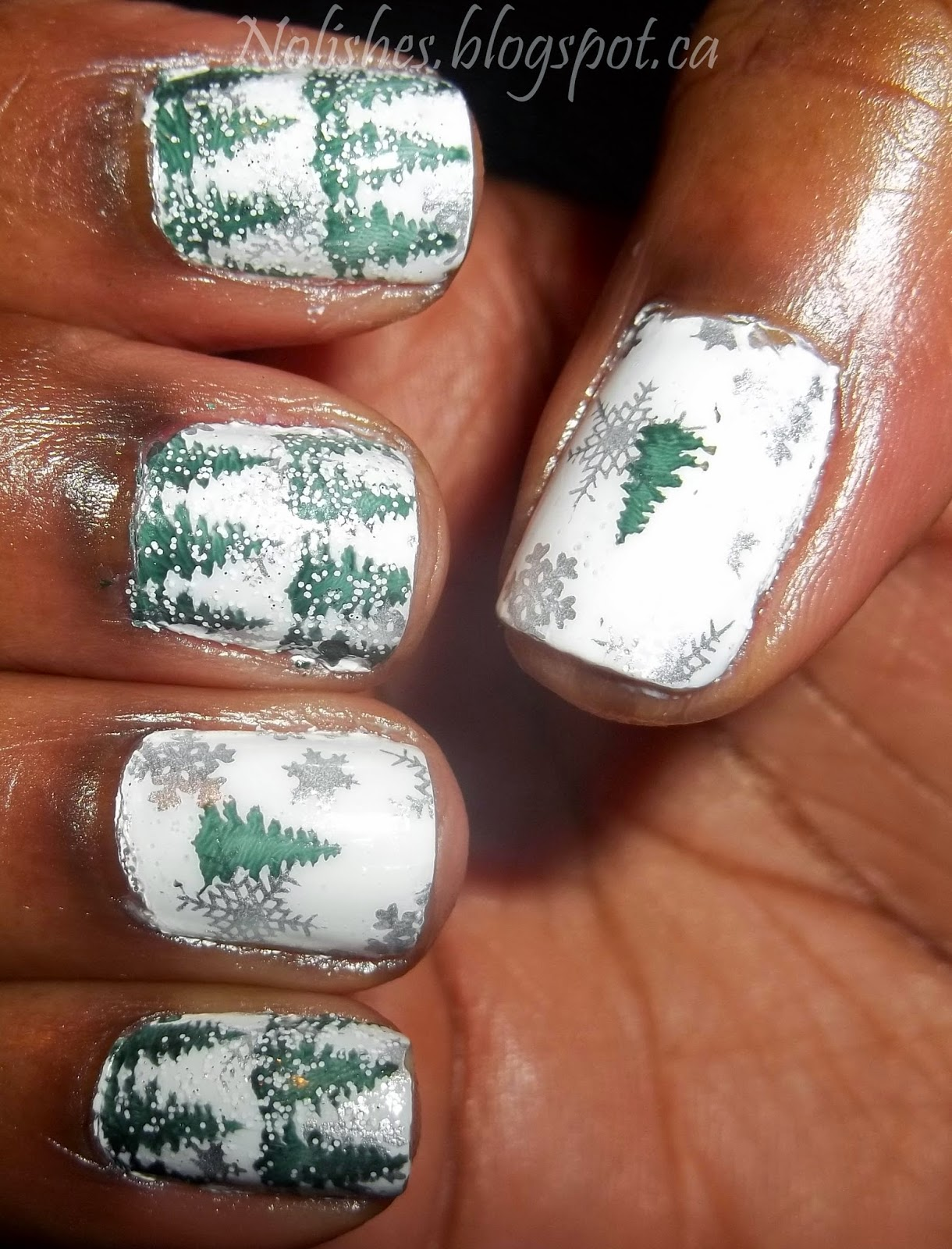 nail stamping manicure featuring forest green pine trees over white background with silver snowflakes - right hand