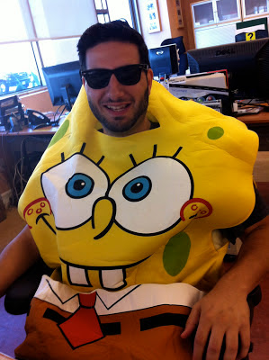 Man dressed as Spongebob with sunglasses