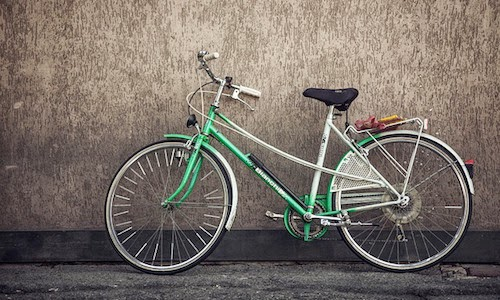 Mastering a cycling workout on a green bike