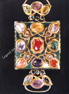 A navaratna, or amulet of the nine planetary stones of Hinduism, set in a bazuband (upper arm tie). The ruby is always placed at t he centre of a navaratna. North Indian, I9th century.