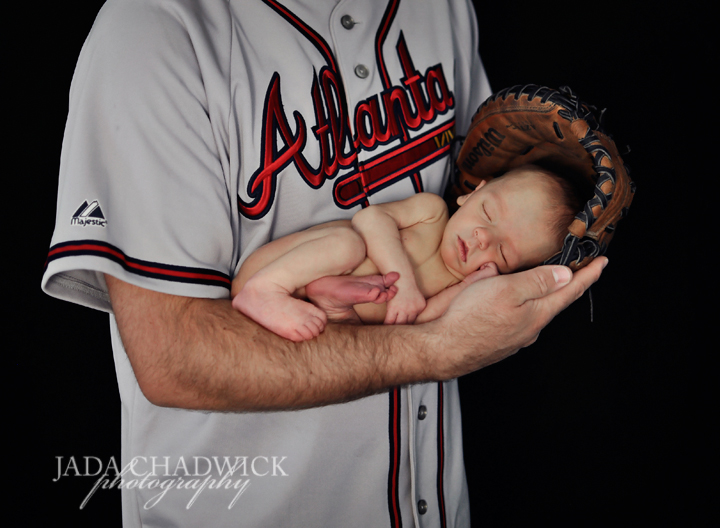 Stockton northern utah newborn photography this adorable baby is already into sports too cute