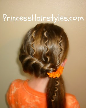 side ponytail hairstyle with ringlets