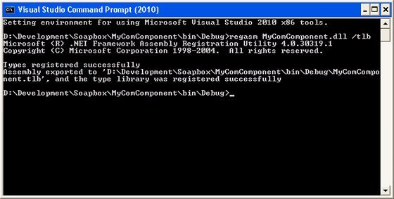 Visual Studio Command Prompt shown registering the assembly for COM Interop using the regasm command.