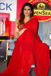 WWW.BOLLYM.BLOGSPOT.COM Bollywooed Actress Raveena Tandon in Red Saree at Seven Seas press meet at Taj el Picture Stills Gallery 0007.jpg