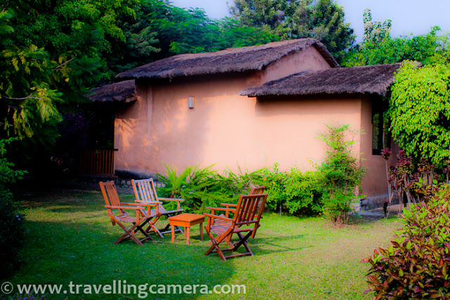 Here is another Photo Journey to Tarangi Resort in Jim Corbett National Park, where we stayed during recent trip to one tiger reserve with maximum number of tigers in India. Since most of us liked the cottages in this resort, I thought of sharing this Photo Journey...Here is a photograph of Cottage with one room and a sitting area attached to it. All the cottages are surrounded by colorful and variety of flowers/plants.There is very low density of cottages, which means more open space which is well utilized for farming or gardening. Path connecting these cottages is beautifully maintained with appropriate plants on both sides.Some of the cottages are facing Kosi river and having nice balconies to sit and enjoy the panoramic view of Kosi river with dense forest in background...Some of the cottages were facing play grounds or gardens. There are three playground near these cottages, which can be used for Cricket, Volleyball etc..Most of the furniture & lighting stuff is created in ethnic style and most of the stuff is taken care respectively..Nice seating arrangements around these cottages for morning/evening tea/snacks :Here is a photograph showing one of the cottage with nice lawn having seating arrangements @ Tarangi Resort, Jim Corbett National Park, Uttranchal, INDITarangii resort has huge area and most of that is open and very well maintained.This story is not any promotional stuff, but personal view expressed with photograph