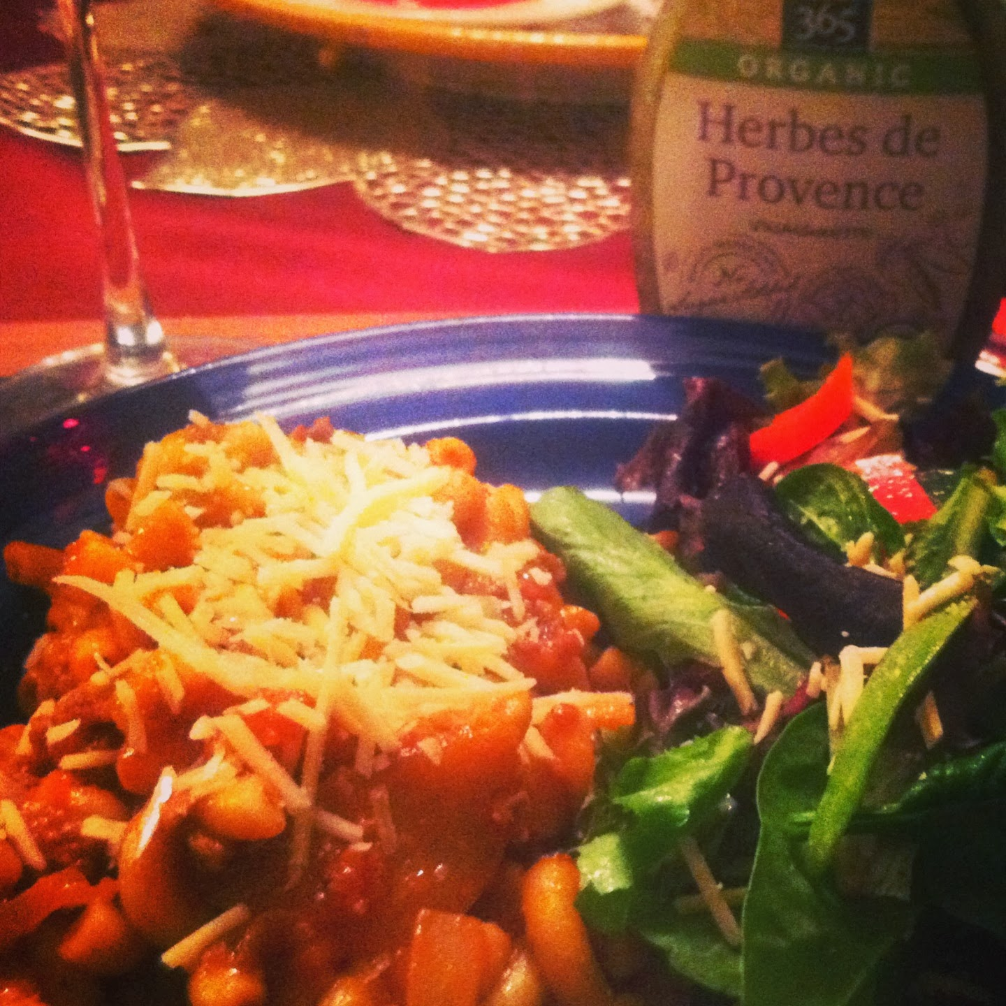pasta with meat sauce served with green salad and Herbes de Provences dressing