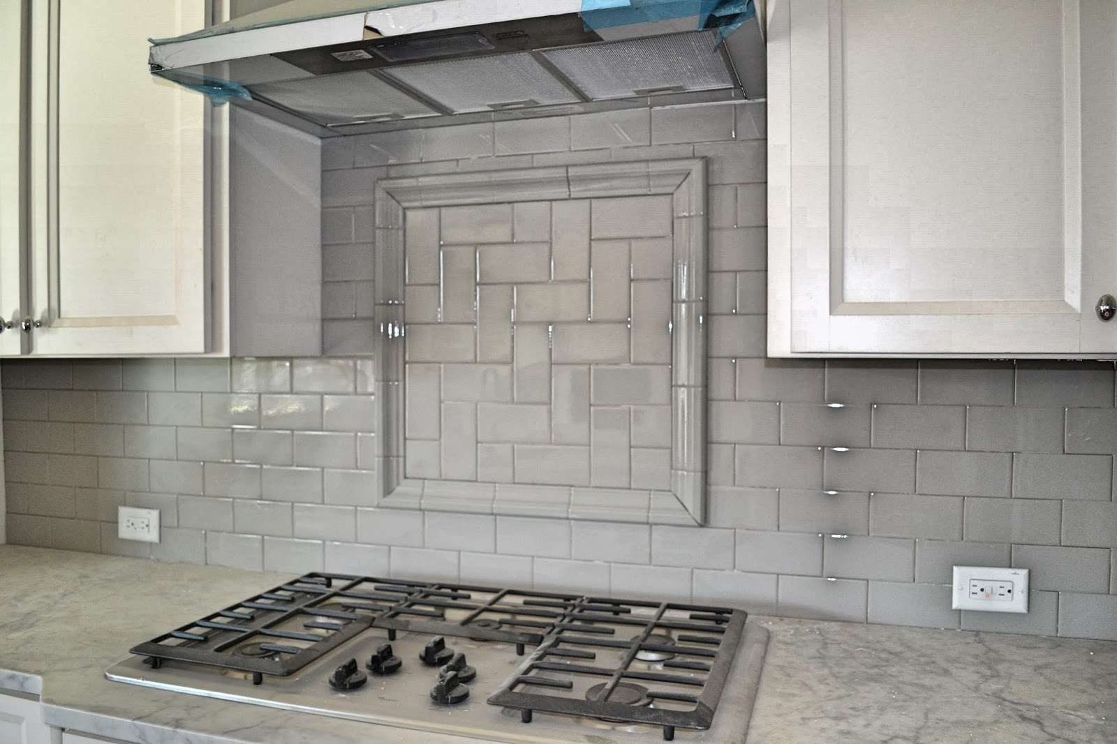 glossy-gray-subway-tile-kitchen-backsplash