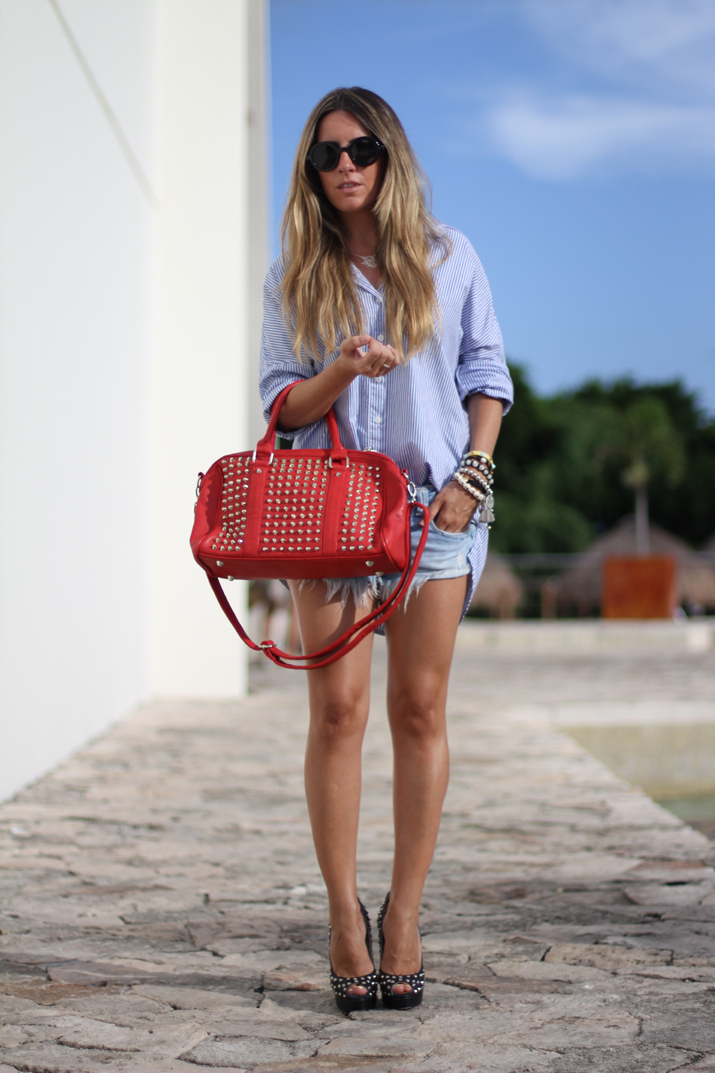 Studded bag and denim shorts