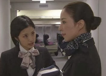 Misaki questions Instructor Mikami in the hall after class.