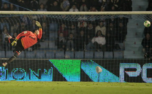 Real Madrid goalkeeper Adan fails to save a goal from Celta player Cristian Bustos