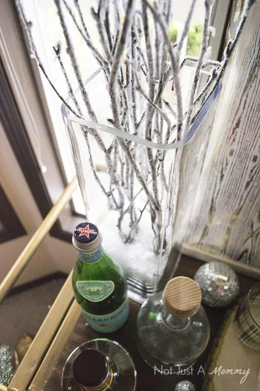 How To Decorate Your Home For The Holidays With Big Lots; snow covered branches are a lovely way to decorate