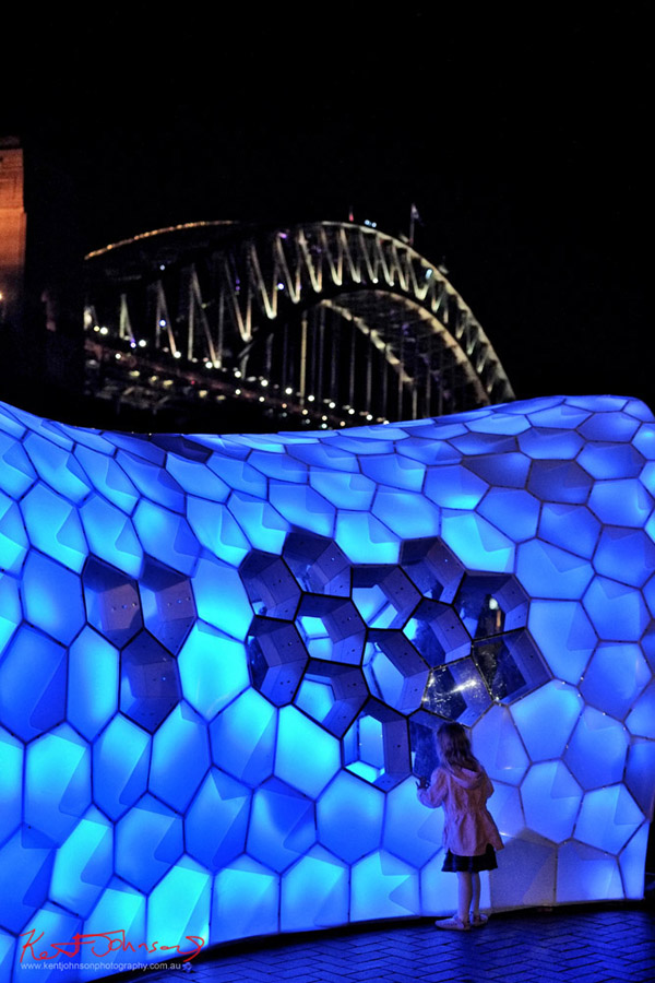 Blue room with Sydney Harbour Bridge behind at Vivid Sydney. Photography by Kent Johnson.