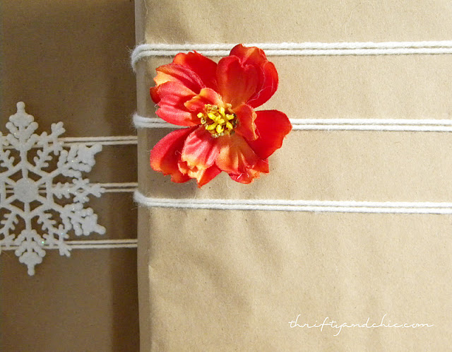 neutrally wrapped presents with kraft paper and yarn