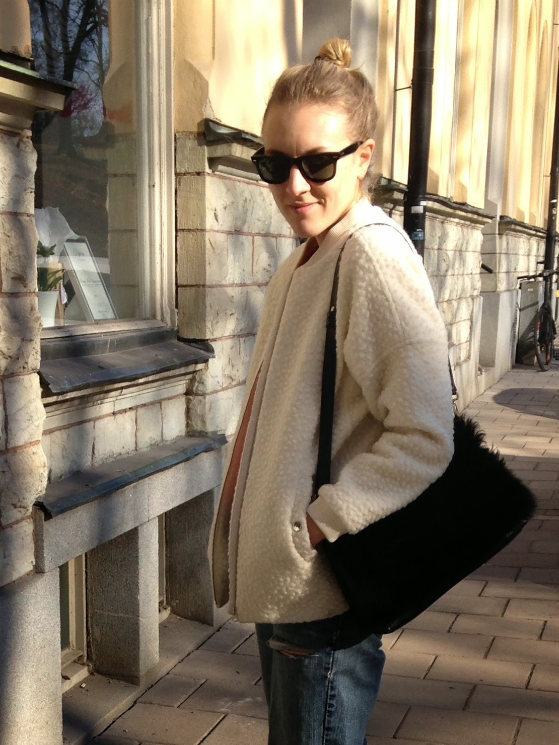 Ray-Bans, Tiger of Sweden bag and white bomber jacket