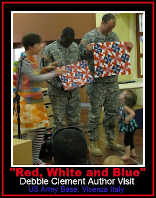 photo of: Author Illustrator Visit to US Army Base in Italy, Comparing original Quilt to Finished Book