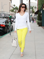Eva Longoria bright yellow pants and white top