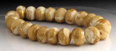 Ivory and gold leaf etched lampwork beads