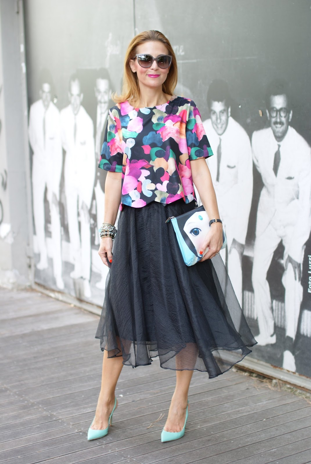 feminine and flirty outfit with a black midi tulle skirt and scalloped hem blouse on Fashion and Cookies fashion blog, fashion blogger style