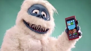 Abominable snowman with smart phone