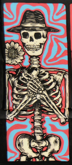 details of street art piece by broken fingaz in amsterdam - skeleton details