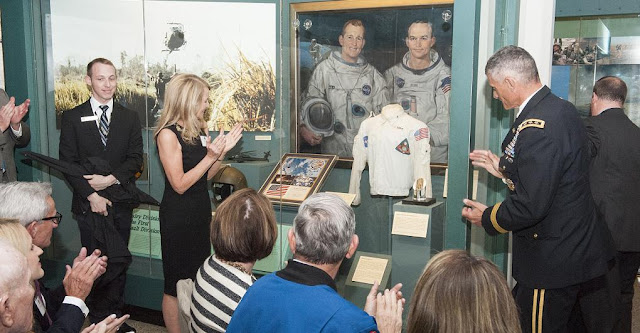 West Point Superintendent Lieutenant General Robert L. Caslen Jr. (right of display) presented a lunar sample with the award to NASA astronaut Ed White's daughter, Bonnie Baer (left of display), during a ceremony at the military academy's museum on June 3, 2015. Credits: NASA