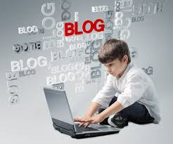 a student blogging on a laptop