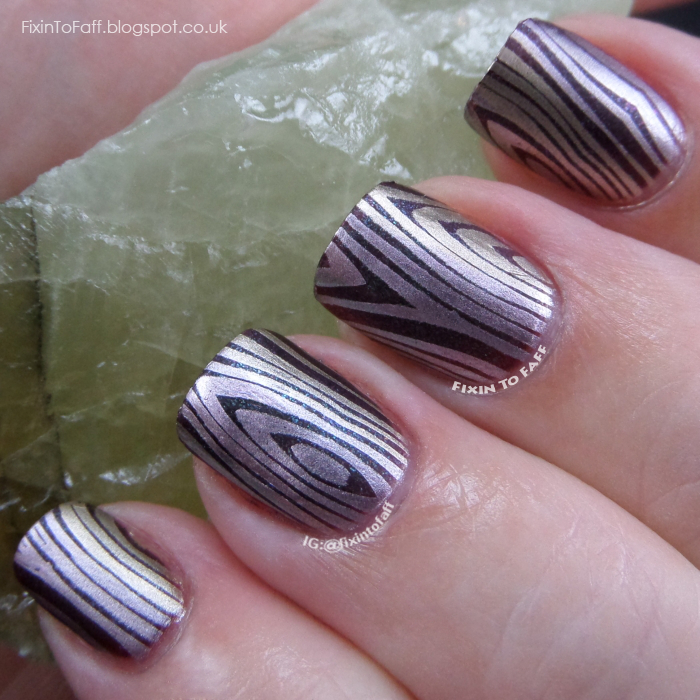 Metallic wood grain nail art using the stamping gradient technique.