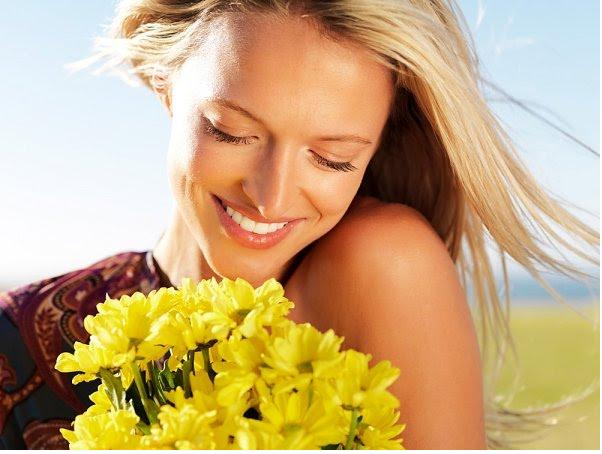 Girl Taken the Flowers and Happy