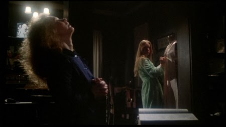 Margaret White (Piper Laurie) prays, in fear of the dance, while Carrie (Sissy Spacek) sews her prom dance in anticipation of it in this scene from CARRIE (1976) that shows conflict visually.
