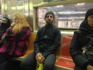 Picture of Brin wearing google glasses on NYC subway.