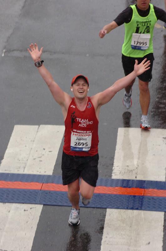 Crossing rainy LA Marathon 2011 Finish Line