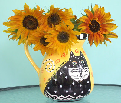 Pretty Warm Sunflowers in a Vase