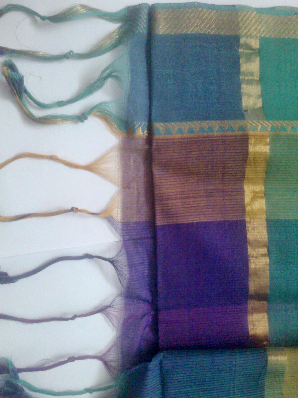 Threads ties at the end of the pallu to a Saree