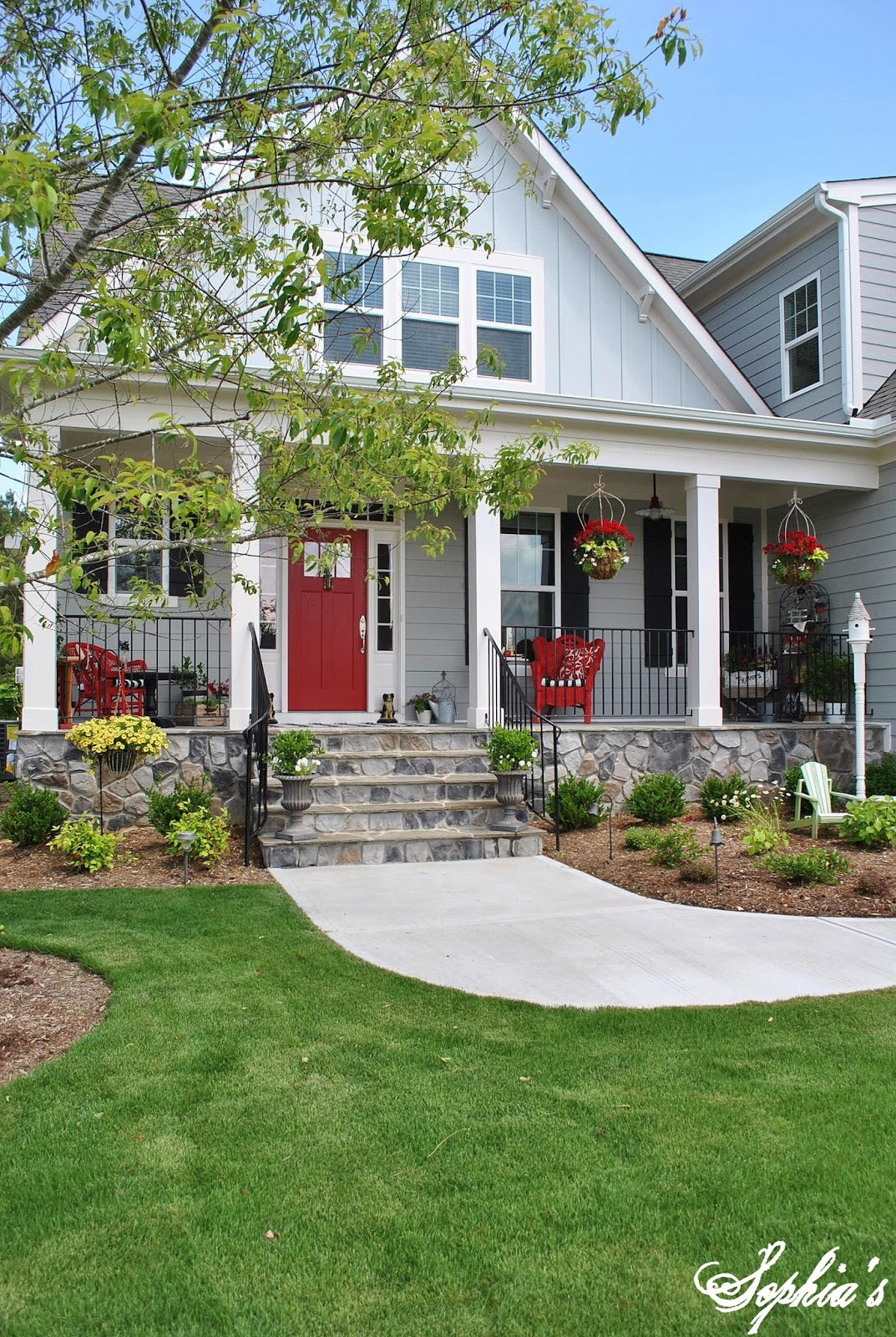 Sophia 39 s farmhouse style front porch with pops of red for Farmhouse homes