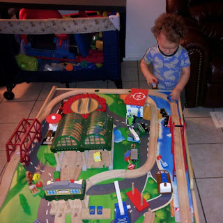 2 year old toddler playing trains
