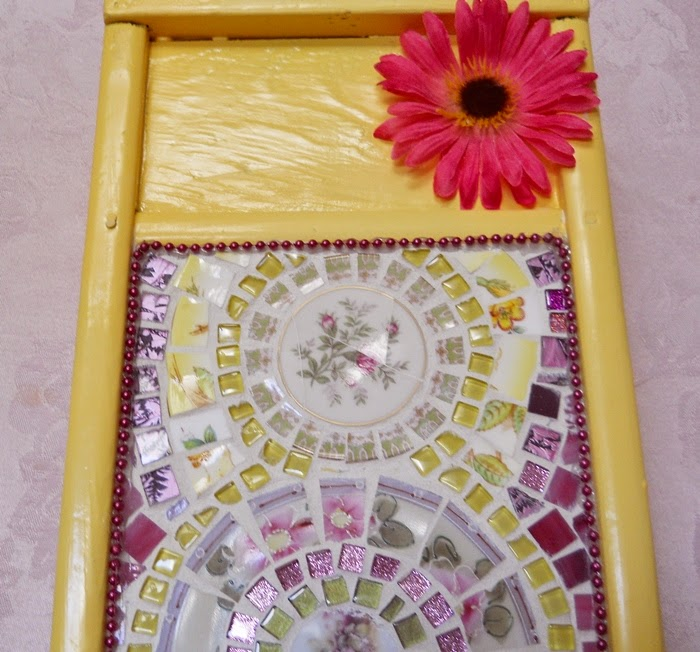 https://handmadeartists.com/product-details/Mosaic/Wall%20Art/Handmade%20Mosaic%20Wall%20Art%20Washboard%20Design%20bright%20yellow%20glitter%20mosaic/?pid=20140620185214c509a