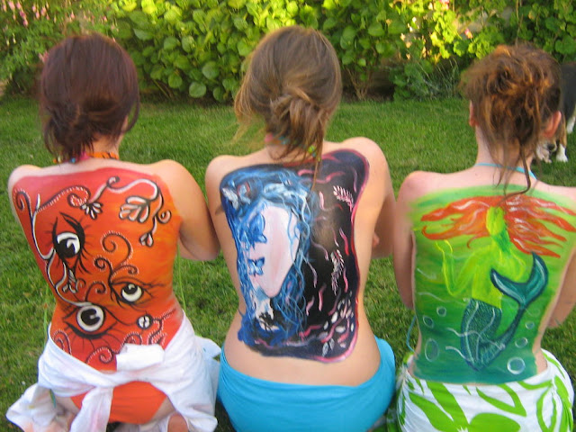 girl full body paint on his back