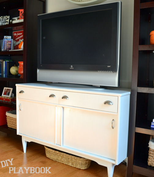 Our new TV stand after we painted it and added new handles and drawer pulls!