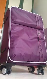 Hush Puppies purple luggage