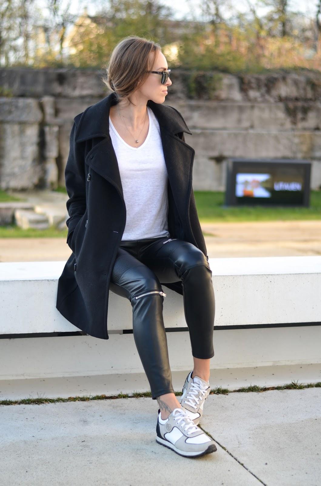 kristjaana mere black peacoat leather pants white sneakers winter outfit