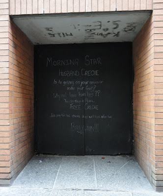 Chalked doors opposite The Morning Star in Belfast's Pottingers Entry