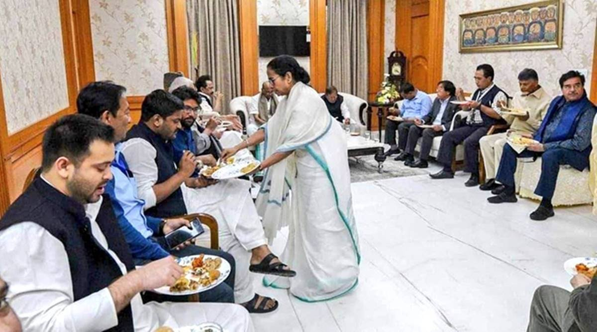 CM Mamata Banerjee serving food