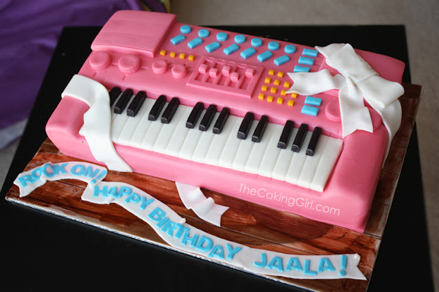 pink piano keyboard cake
