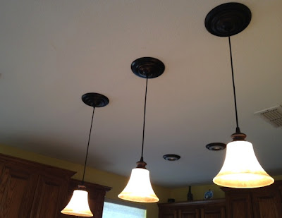 This kitchen ceiling sports three instant pendant lights in a bronze finish.